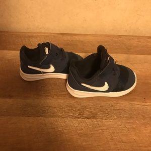 Blue toddler Nike shoes